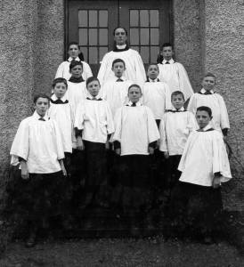 Revd C H Barker with Choir Boys c 1920